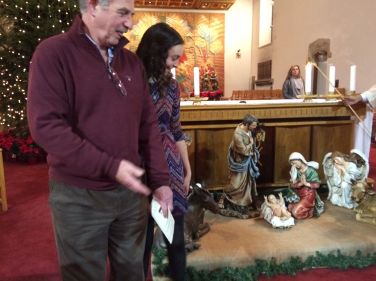 My uncle and I attempting to take a picture with the nice Nativity scene
